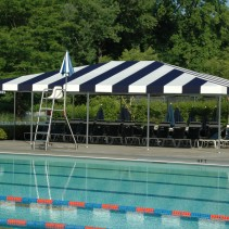 NH Awning Installs an Awning Poolside.