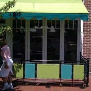 Colorful Awning With Matching Railings.
