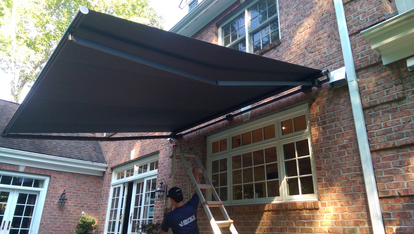 ... New Retractable Awning Installed By Dean And The Rest Of The New Haven  Awning Crew! Now These Lucky Customers Can Keep Their Company Cool And Dry  While ...