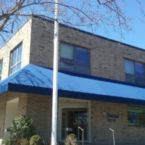 Patriot Bank in Greenwich Connecticut Gets Their Awnings Recovered!